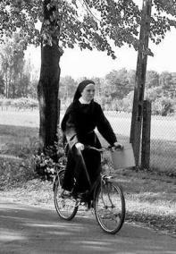 nun on bicycle